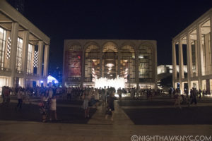 """Because the night"" is over, the crowd spills out from the left. L-R CIty Opera & Ballet, Damrosch Pk (Blue Dome), Met Opera, Lincoln Ctr Library, Geffen (Philharmonic) Hall"