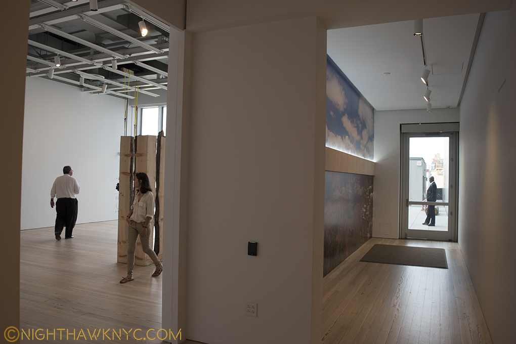 The 5th Floor is cut to allow this exit corridor to the Roof Deck Gallery, leaving a small gallery to the left that feels lost.